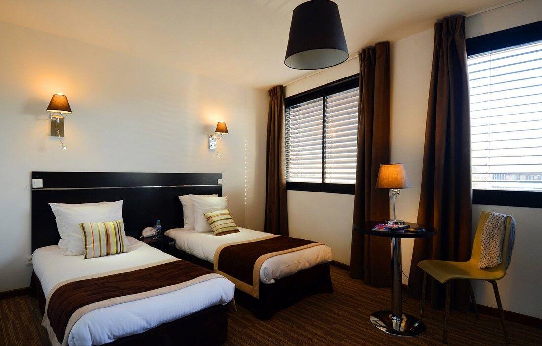 Ferney-Voltaire - Appart'hôtel Odalys Ferney Genève : Intérieur d'un logement