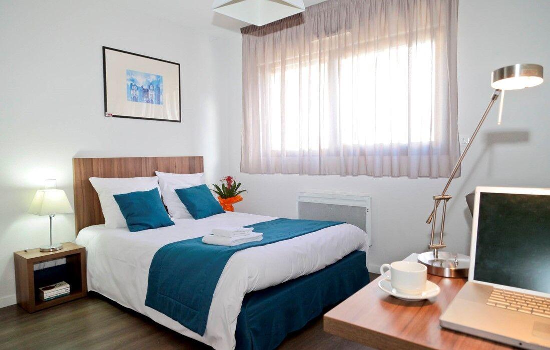 Tours - Appart'hôtel Odalys Le Jardins des Lettres : Intérieur d'un logement