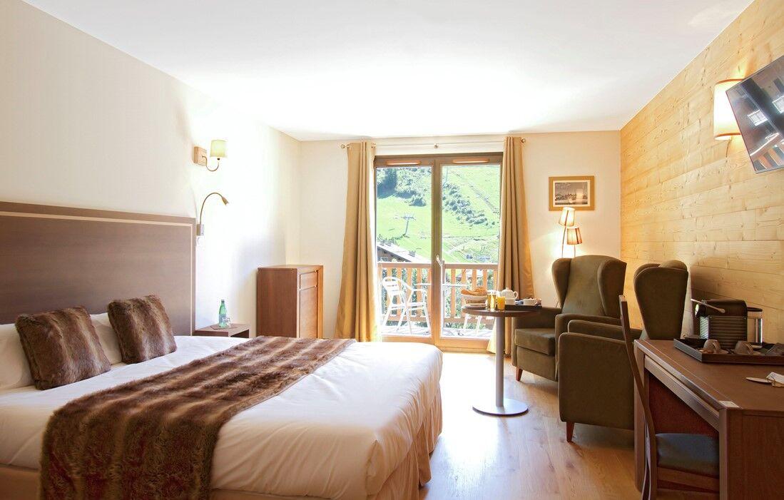 La Clusaz - Hôtel Prestige Odalys Le Chamois : Intérieur d'un logement