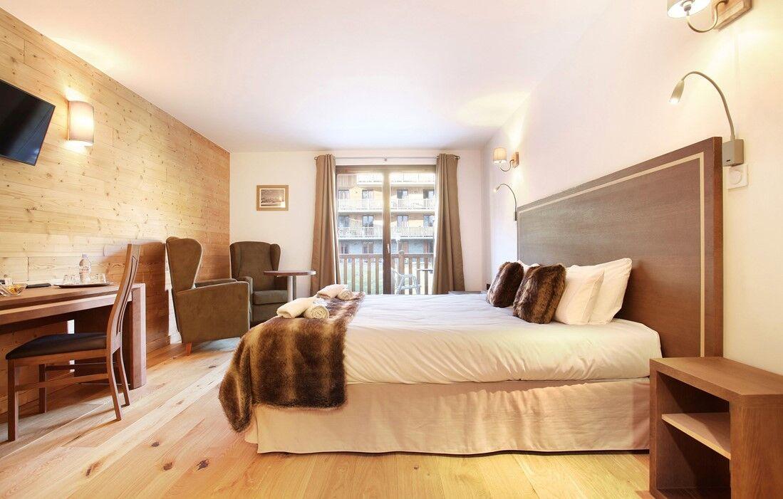 La Clusaz - Hôtel Prestige Odalys Le Chamois : Intérieur d'une chambre