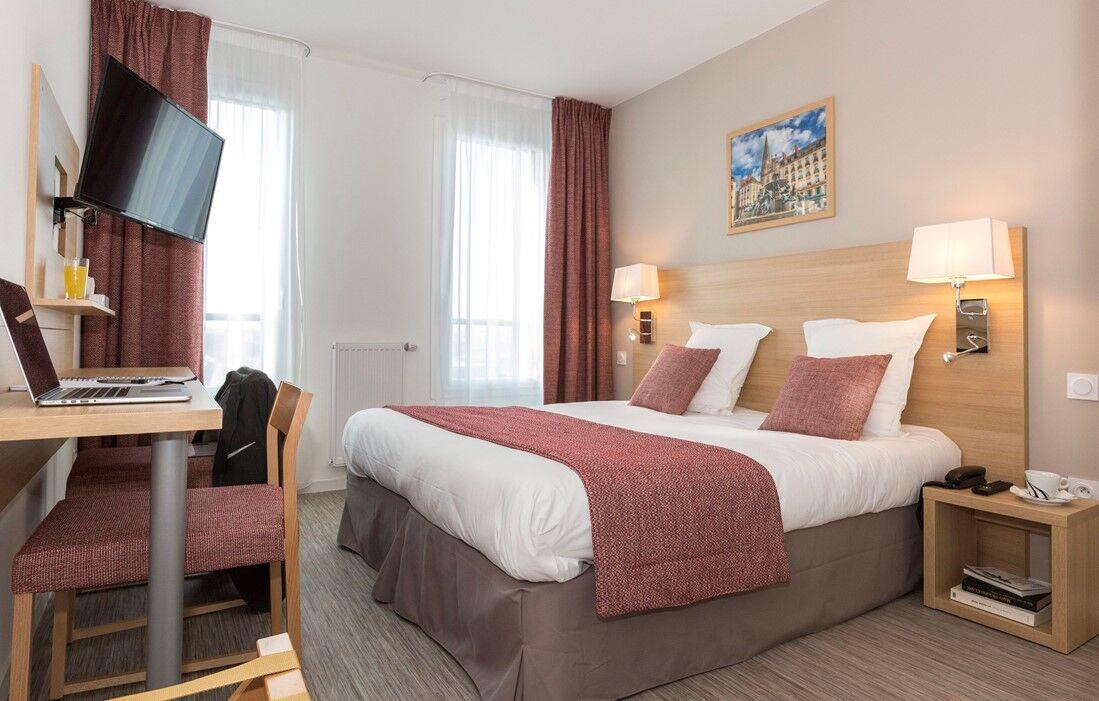 Nantes - Appart'hôtel Odalys Nantes Cité des Congrès : Intérieur d'une chambre
