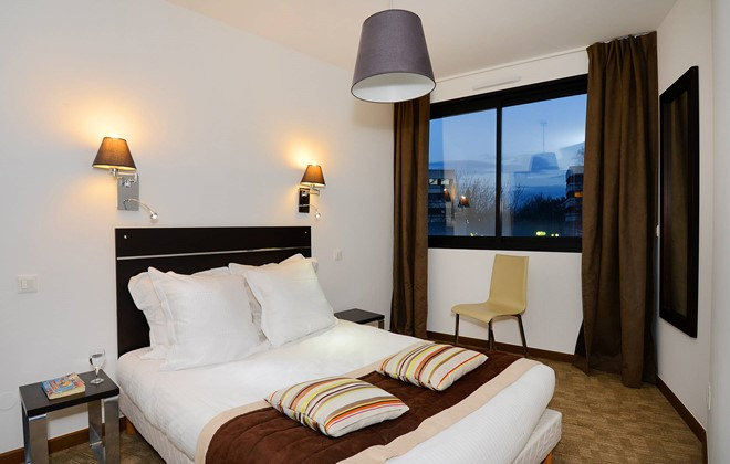 Location ferney voltaire appart 39 h tel odalys ferney gen ve for Appart hotel corse