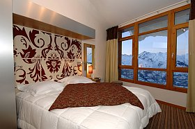 intérieur d'une chambre résidence Edenarc pour vacances aux Arcs